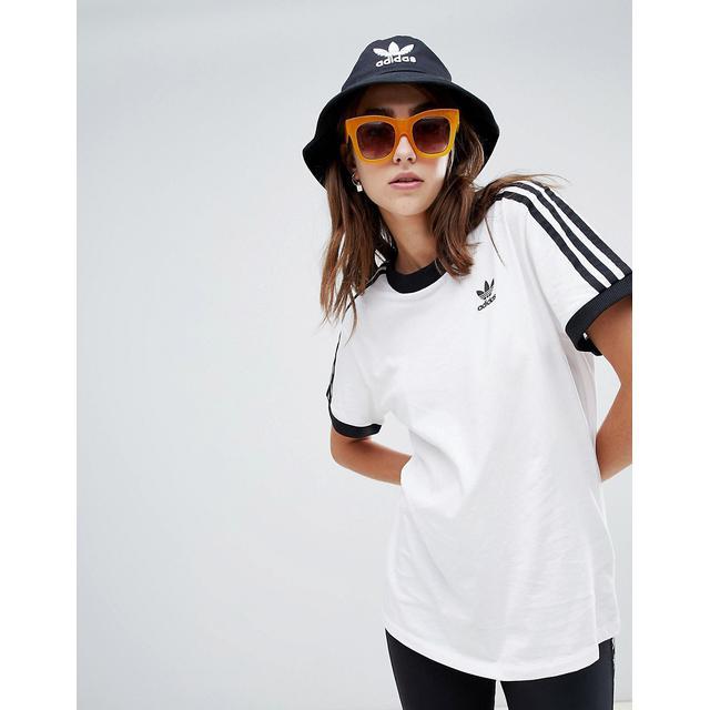 ce751e3584 Adidas Originals - Adicolor - T-shirt Bianca Con Tre Strisce - Bianco from  ASOS on 21 Buttons