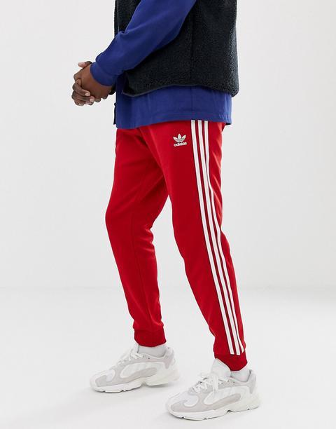 Adidas Originals Dv1534 Pantalon De Jogging Ajusté À 3 Bandes Resserré Aux Chevilles Rouge from ASOS on 21 Buttons