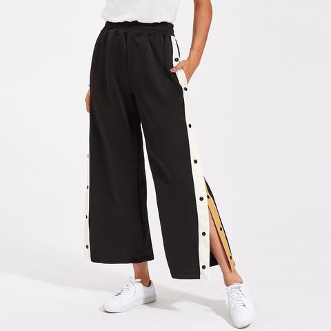 pantaloni nike con bottoni laterali