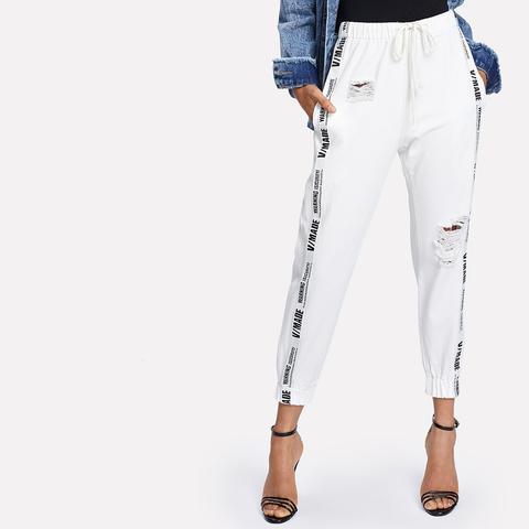 Pantaloni Stampati Strappati di SheIn su 21 Buttons